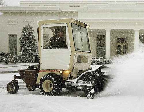 Grashopper mower plowing snow