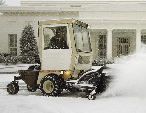 Grashopper mower plowing snow